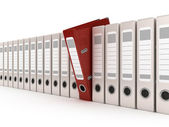 Red ring binder standing out from a row of files — Stock Photo