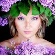 Girl with a sweet bouquet of lilacs — Stock Photo #9564479