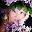 Girl with a sweet bouquet of lilacs — Stock Photo