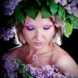 Girl with a sweet bouquet of lilacs — Stock Photo #9564482