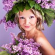 Stock Photo: Girl with a sweet bouquet of lilacs