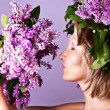 Girl with a sweet bouquet of lilacs — Stock Photo #9564484