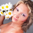 Girl with a sweet bouquet of daisies — Stock Photo