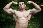 Attractive muscular man — Stockfoto