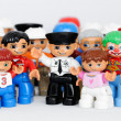 A group of Lego brand Duplo Figures with happy faces - Stock Photo