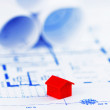 Red model house with architecture plan — Stock Photo