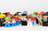 A group of Lego brand Duplo Figures with happy faces — Stock Photo