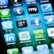 Social Media Apps on Apple iPhone 4 - Stock Photo