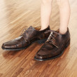 Toddler wearing adult shoes — Stock Photo