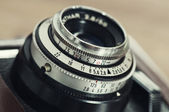 Lens and exposure controls of vintage camera. — Stock Photo