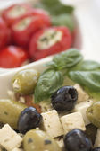 Salad of black, green olives with pieces of cheese. — Stock Photo