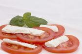 Salad of tomatoes, cheese and basil. Horizontally. — Stock Photo