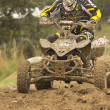 Stock Photo: Quad motorbike rider in mud