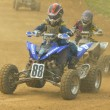 Young boys in Quad motorbike racer - Stock Photo