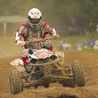 Quad motorbike racer going up the hill — Stock Photo