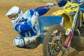 Sidecar rider balancing machine in turn and looks forward — Stock Photo