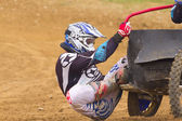Sidecar rider balancing machine in turn. He touches the ground. — Stock Photo