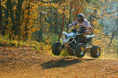ATV rider jumps — Stock Photo