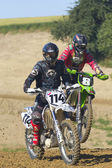 Two motorbike riders in the race. — Stock Photo