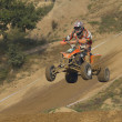 ATV motorbike rider jumps — Stock Photo