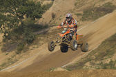 ATV motorbike rider jumps — Stock Photo