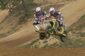 Sidecacross riders jump with motorbike — Stock Photo