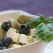Salad of black, green olives with pieces of cheese. — Stok fotoğraf