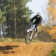 Motocross rider jumps (nice shadow) — Stock Photo
