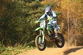 Motocross rider jump — Stock Photo
