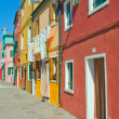 Stock Photo: Red and yellow houses in Burano (Italy)