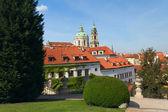 Prague. View of the Church of St. Nicholas from Vrtbovska garden — Stock Photo