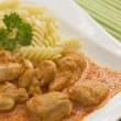 Chicken pieces with Pasta in Paprika Cream Sauce. Horizontally. — Stock Photo
