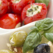 Salad of black, green olives with pieces of cheese. - Stockfoto