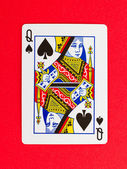 Old playing card (queen) isolated on a red background — Stock Photo