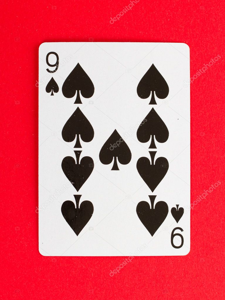 Old playing card (nine) isolated on a red background — Stock Photo #10657725