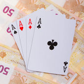 Four aces on top of some 50 euro banknotes — Stock Photo