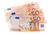 White pills on some 50 euro banknotes — Stock Photo