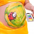 Stock Photo: Pregnant woman's belly