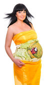 Pregnant woman dressed in yellow tissue — Stock Photo