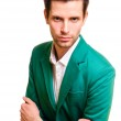 Businessman in a white shirt and green jacket — Stock Photo #10424088