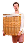 Young man holding a large flasket — Stock Photo