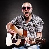 Portrait of a guitarist — Stock Photo
