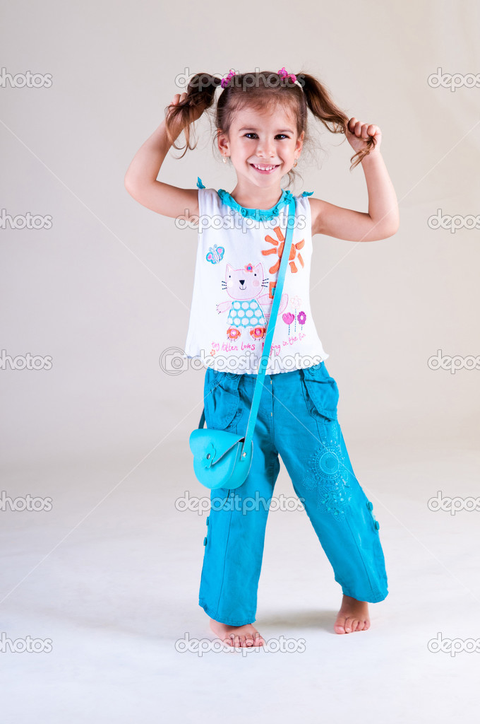 Little funny girl shows her pigtails — Stock Photo #9452641
