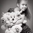 Girl with many toys - Lizenzfreies Foto