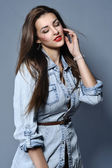 Studio portrait of the pretty young girl wearing denim shirt — Stock Photo