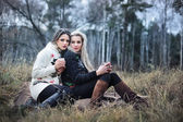 Two attractive young girls on the picnic — Stock Photo