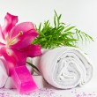 Stock Photo: White towels lillium magenta