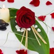 Royalty-Free Stock Photo: White towels with red rose and black stones