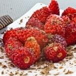 Wild strawberries and grated chocolate — Stock Photo