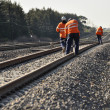 Track Workers working on rail - Stock Photo